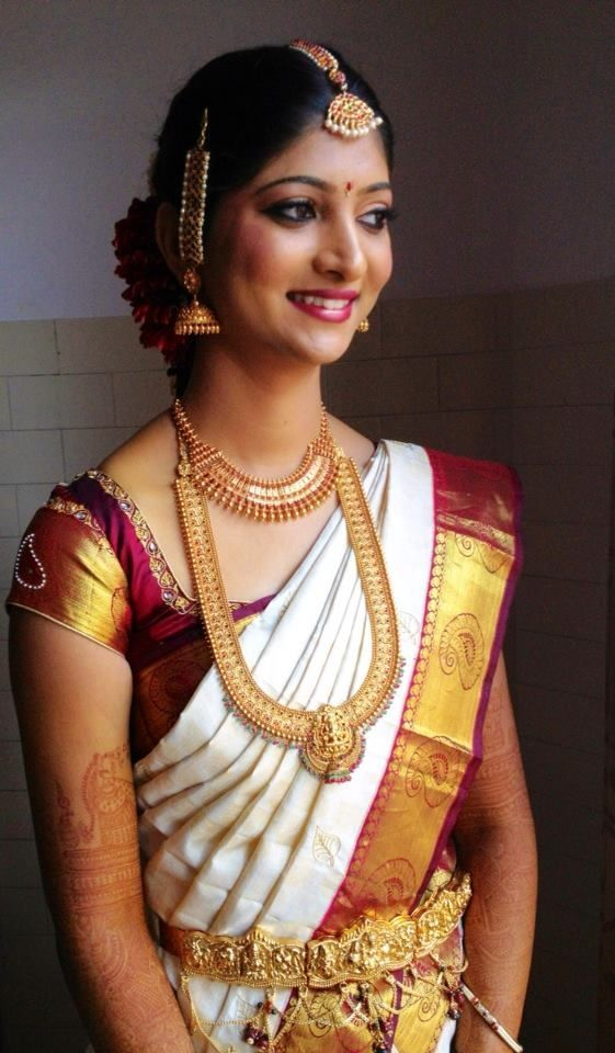 Traditional wedding saree with maroon blouse