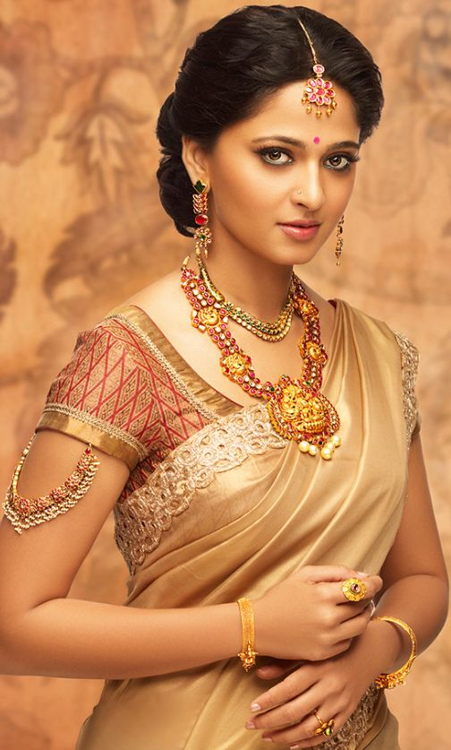 anushka cream wedding saree with blouse