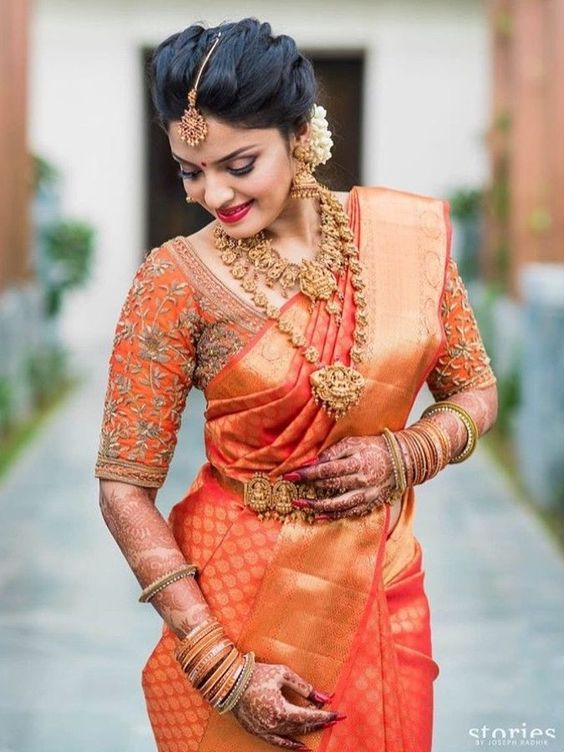 orange bridal saree picture