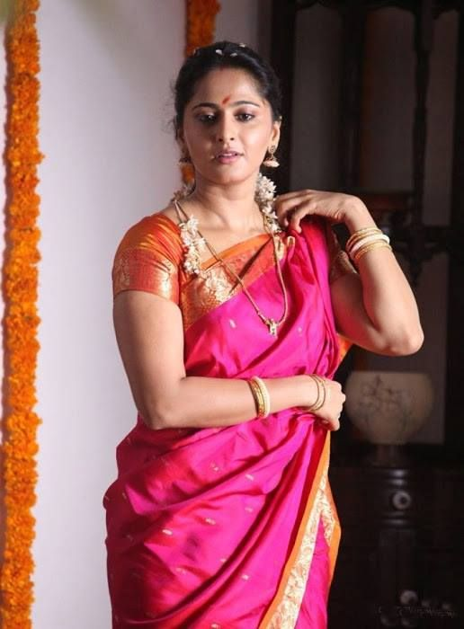 traditional pink wedding saree draped by anushka