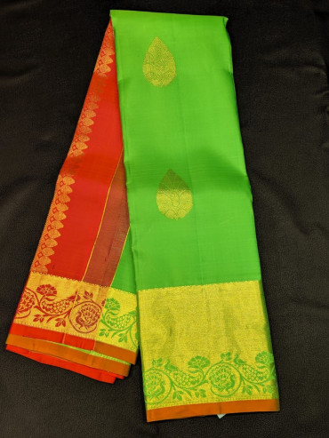 00KANCHI4439PONNU42 - parrot green  colour kanchipuram saree