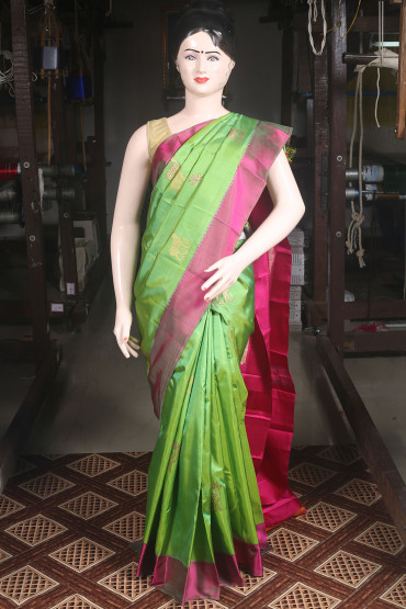 00KANCHI4000AKN101 - parrot green kanchipuram saree with rani pink border