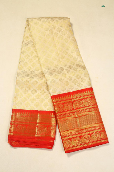 00BRID4574PONNU - Off white kerala wedding silk saree with red gold zari border