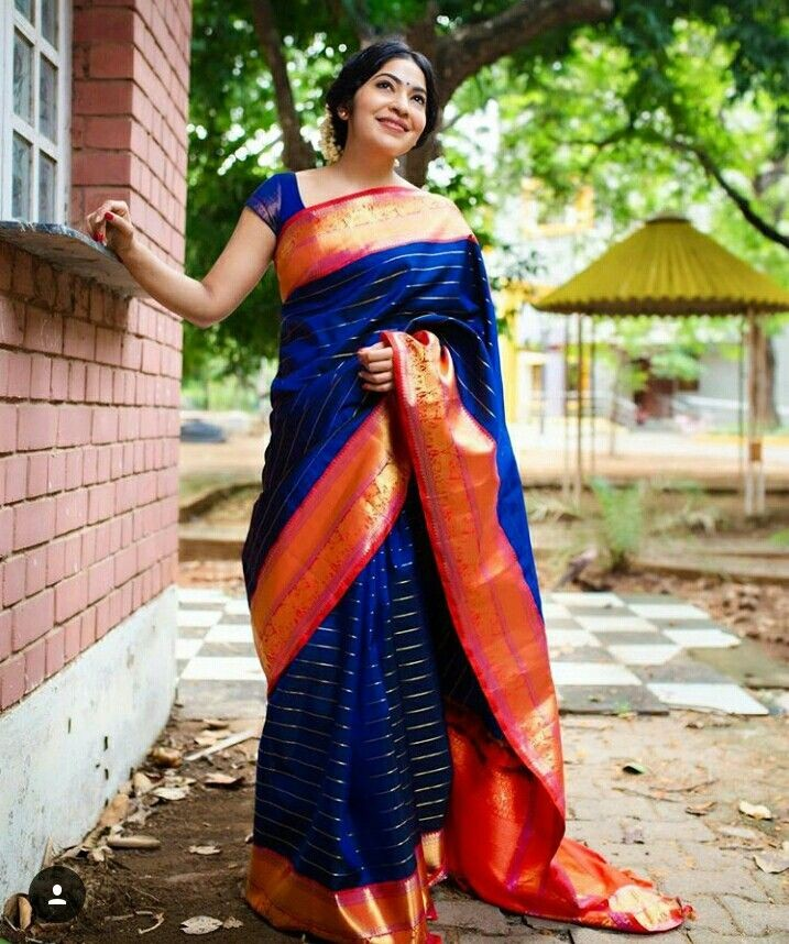 blue stripes kanchipuram saree in contrast border.