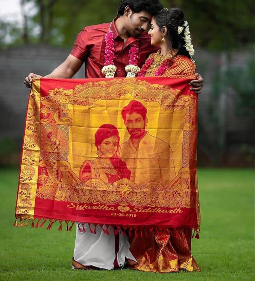 couple photo in wedding saree pallu