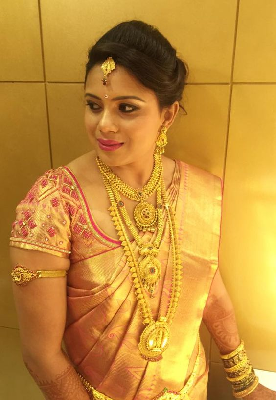 south indian bride in full gold zari wedding saree